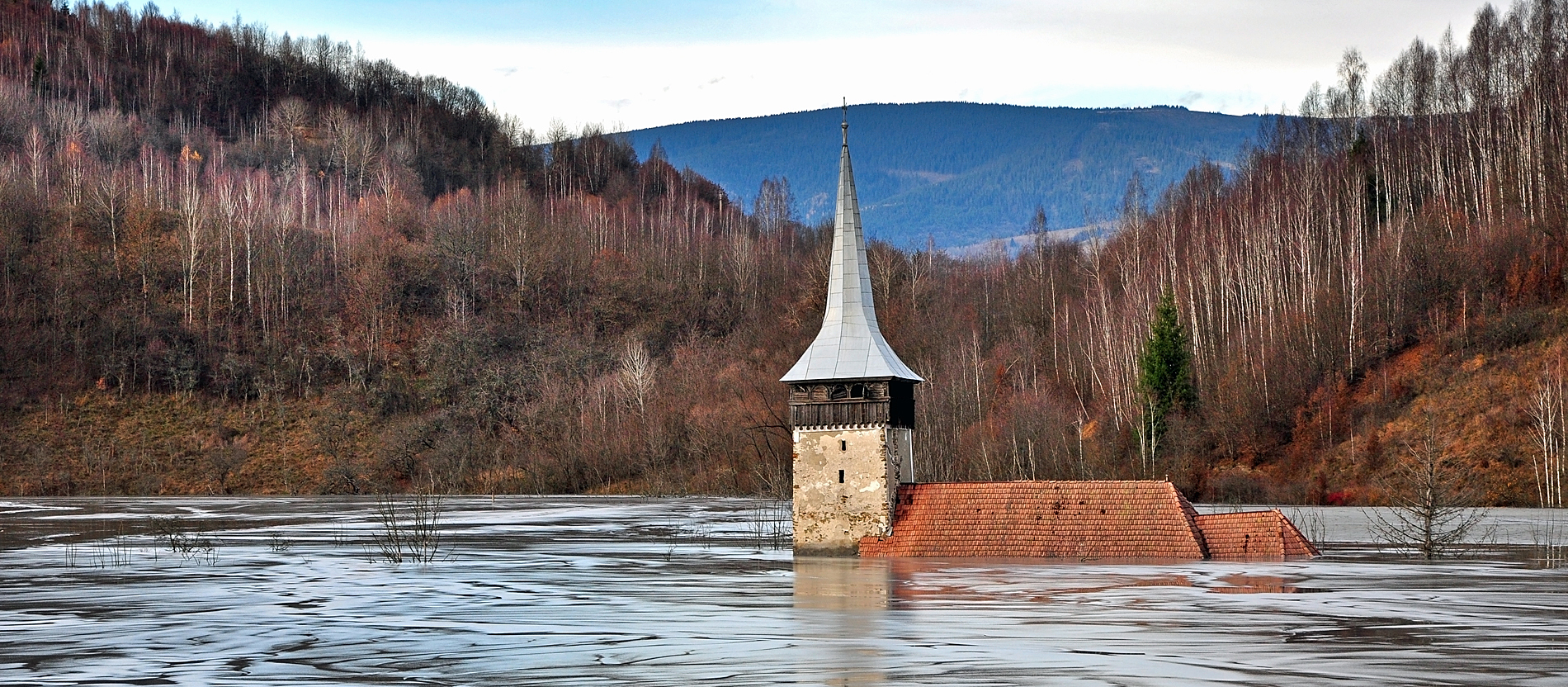 Flooded church by contaminated water and mud. Geamana, Romania