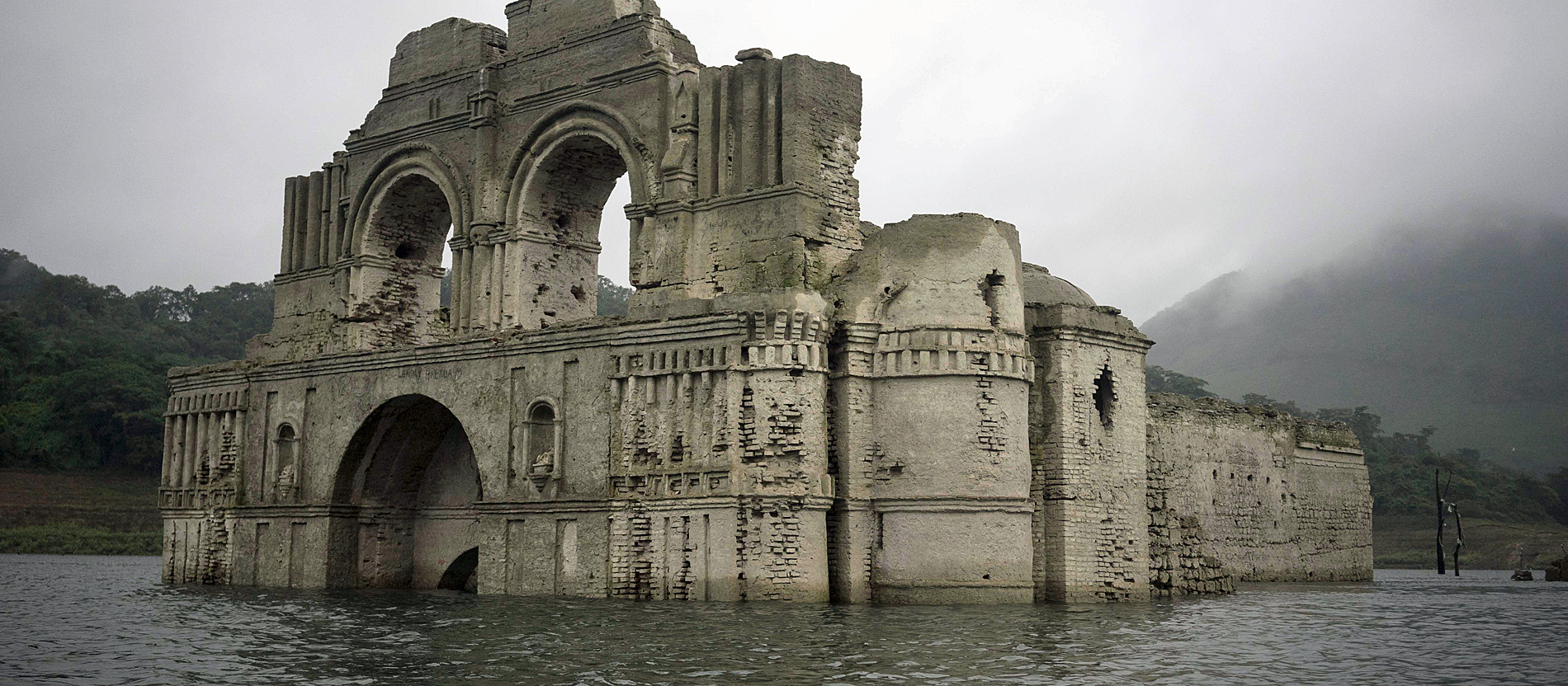 The remains of a mid-16th century church known as the Temple of Santiago, as well as the Temple of Quechula, is visible from the surface of the Grijalva River, which feeds the Nezahualcoyotl reservoir, due to the lack of rain near the town of Nueva Quechula, in Chiapas state, Mexico, Friday, Oct. 16, 2015. ¿The church was abandoned due the big plagues of 1773-1776,¿ said architect Carlos Navarette, who worked with Mexican authorities on a report about the structure that would be flooded in 1966 when the dam was completed. (AP Photo/David von Blohn) |