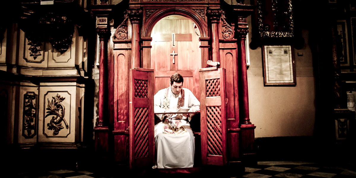 PRIEST IN CONFESSIONAL
