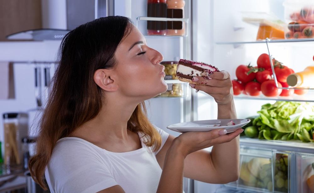 WOMAN EATING SWEET