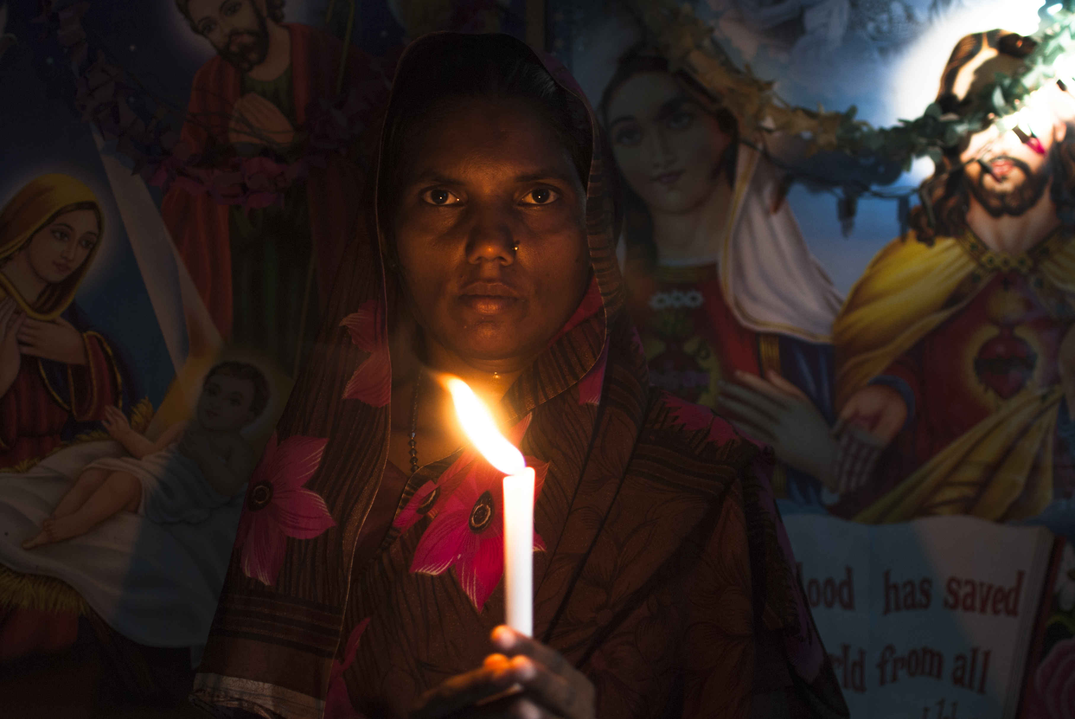 Woman holding candle - NEW DELHI; INDIA - MAY 17TH 2015